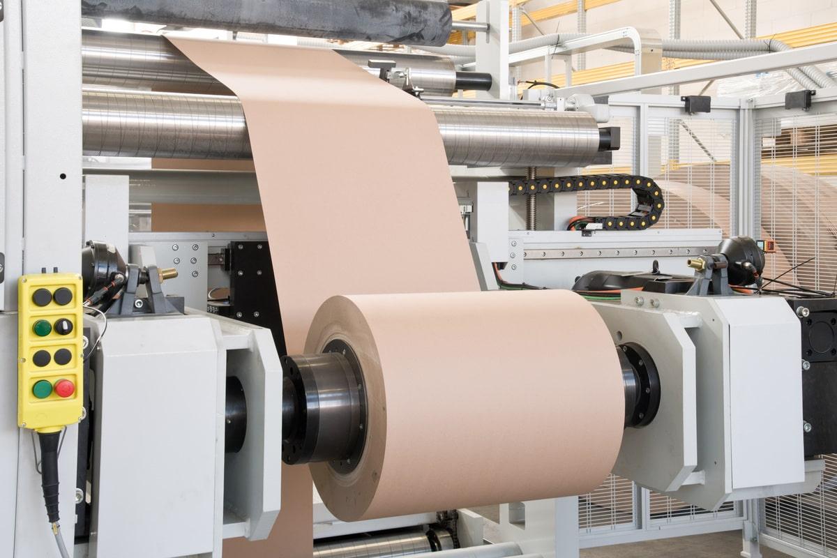 Heavy-duty, shaft-less unwinder for cardboard